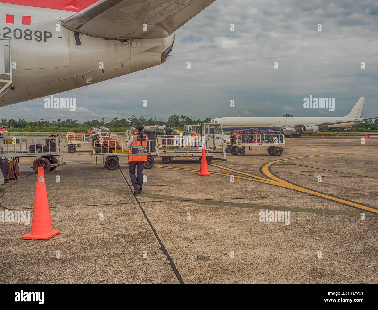 Iquitos, Peru - December 07, 2018: Luggage is waiting to be loaded onto an airplane at Iquitos airport. South America, Latin America - Stock Image