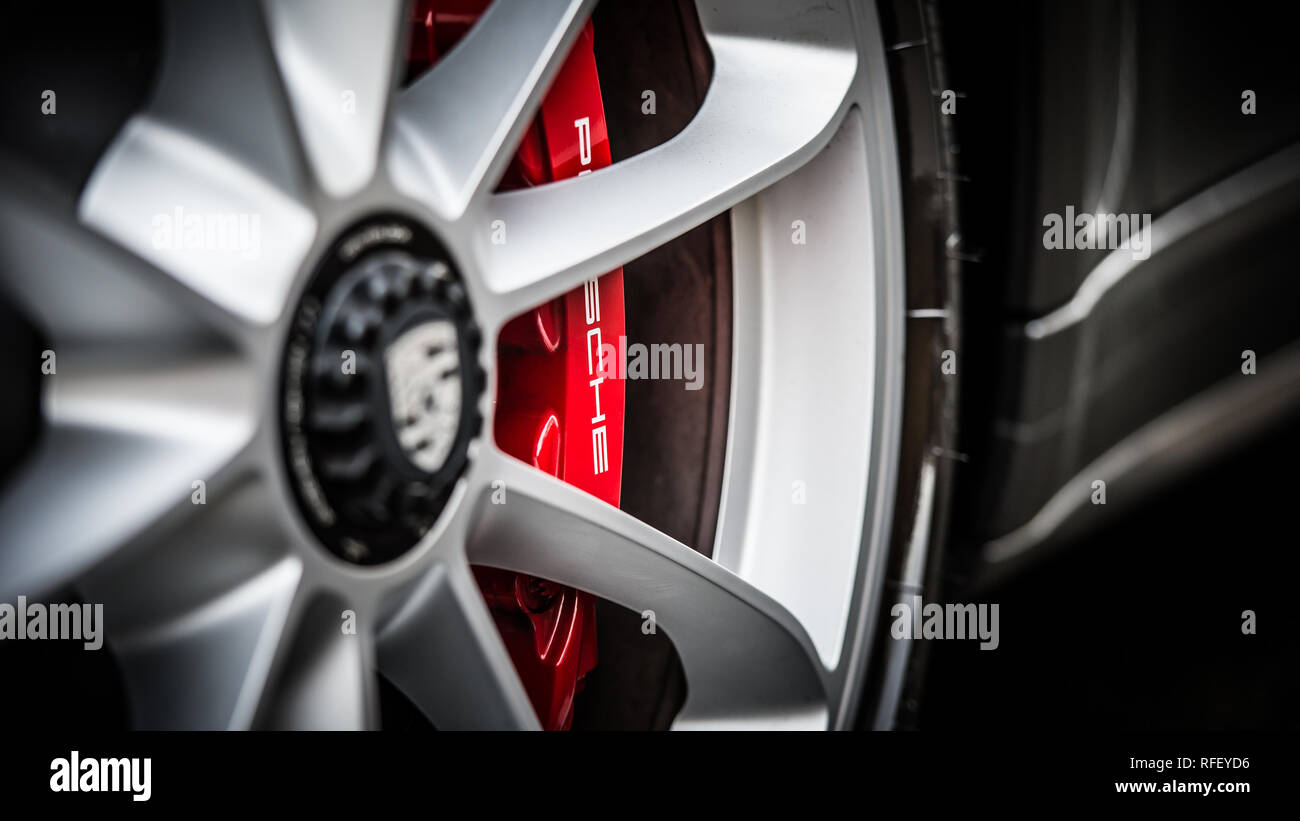 Close up detail image of the alloy wheel & brake calliper of the Porsche 911 GT3 Tourer - Stock Image