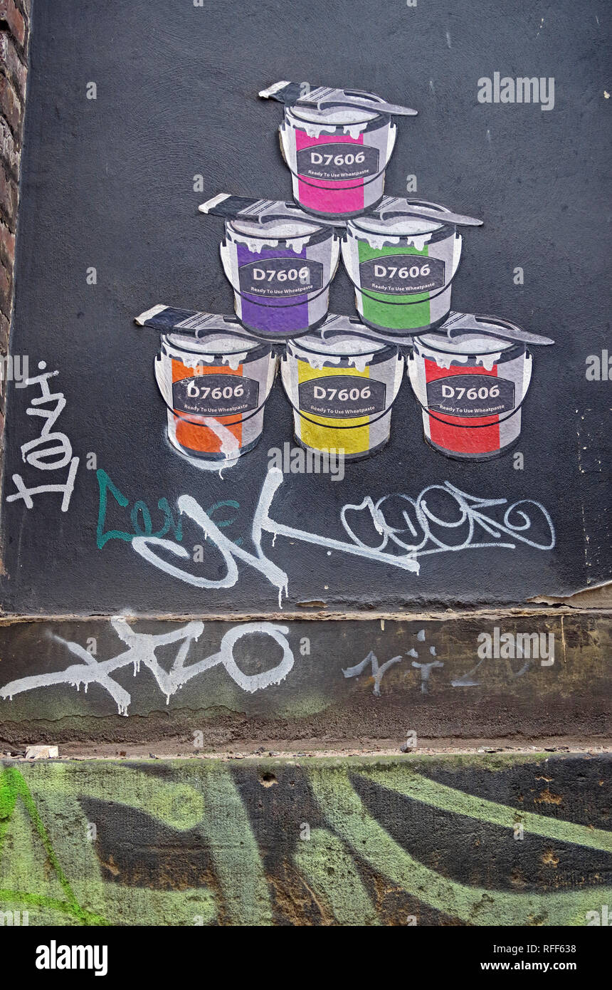 Paint Tins from artist D7606 in various colours, Ready to use Wheatpaste, pop-art, Northern Quarter, Manchester, England, UK - Stock Image