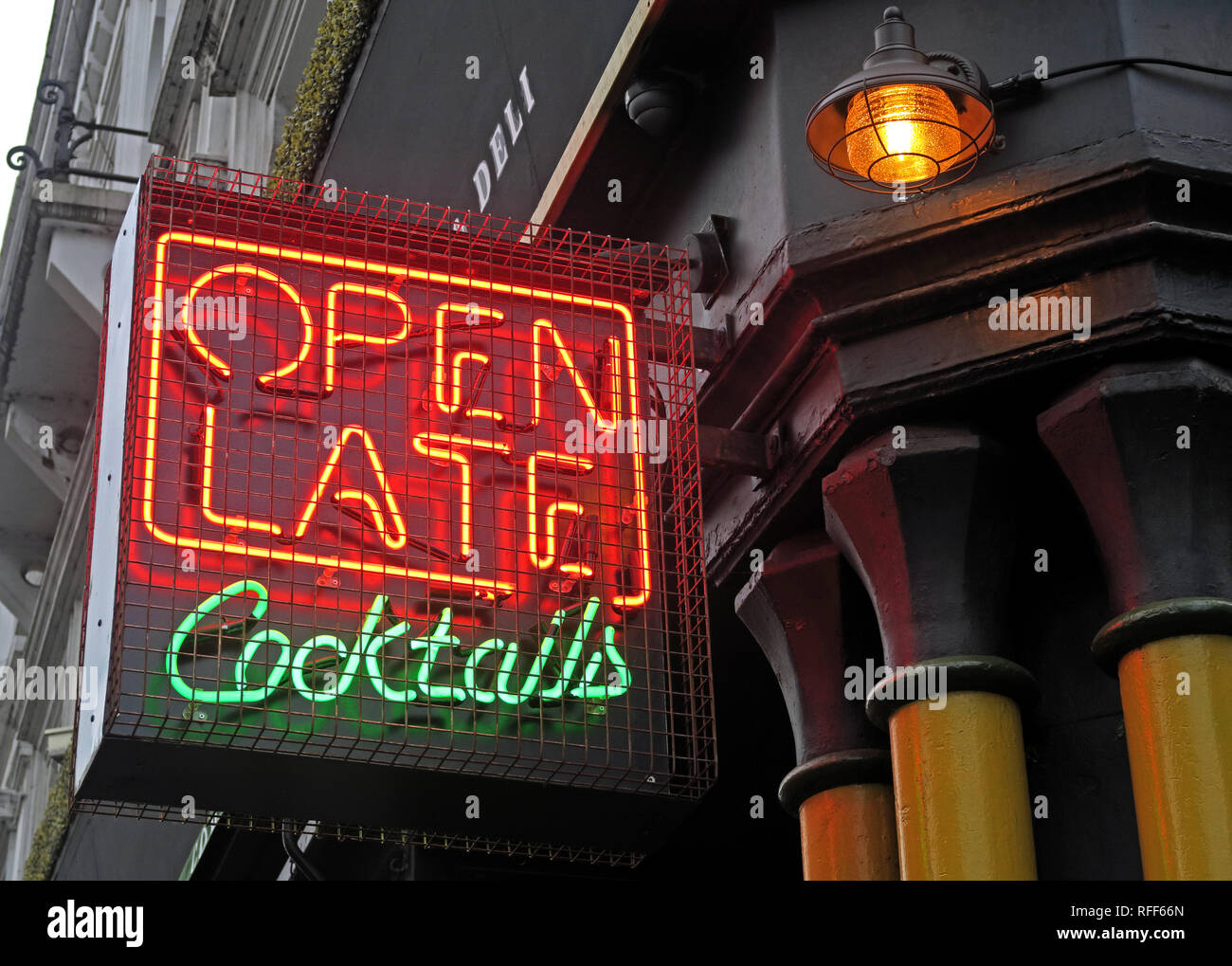 Open Late for Cocktails, Cocktail bar neon sign, Stevenson Square, NorthernQuarter, Manchester, England, UK,  M1 1DN - Stock Image