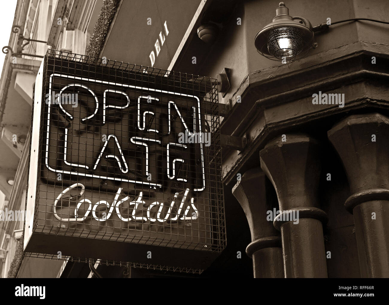 Monochrome Open Late for Cocktails, Cocktail bar neon sign, Stevenson Square, NorthernQuarter, Manchester, England, UK,  M1 1DN - Stock Image