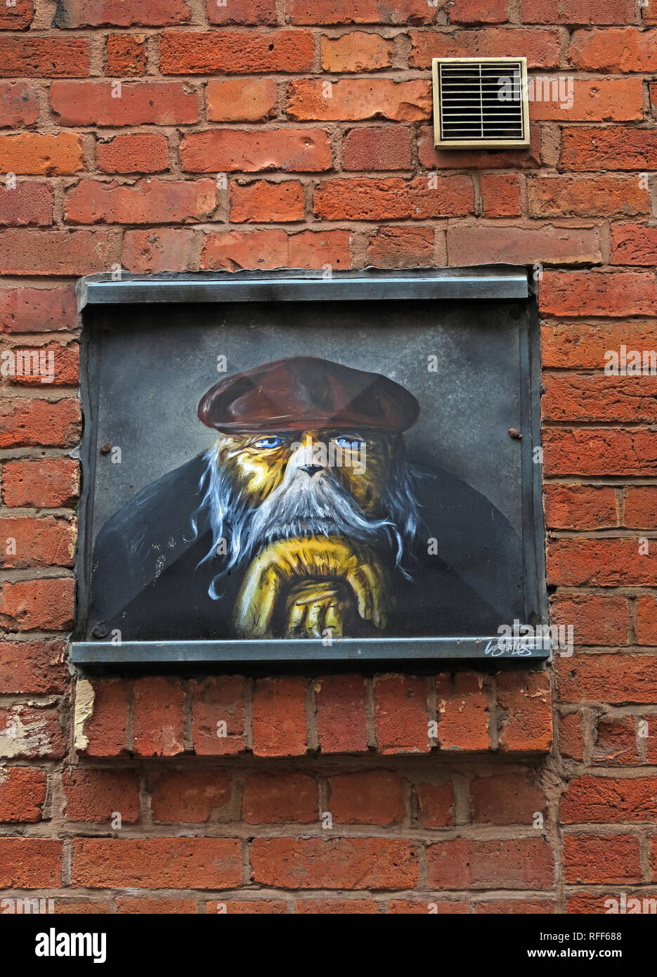 Dog man, dogface in cloth cap, Houldsworth Street, Northern Quarter, Manchester, England, UK - Stock Image