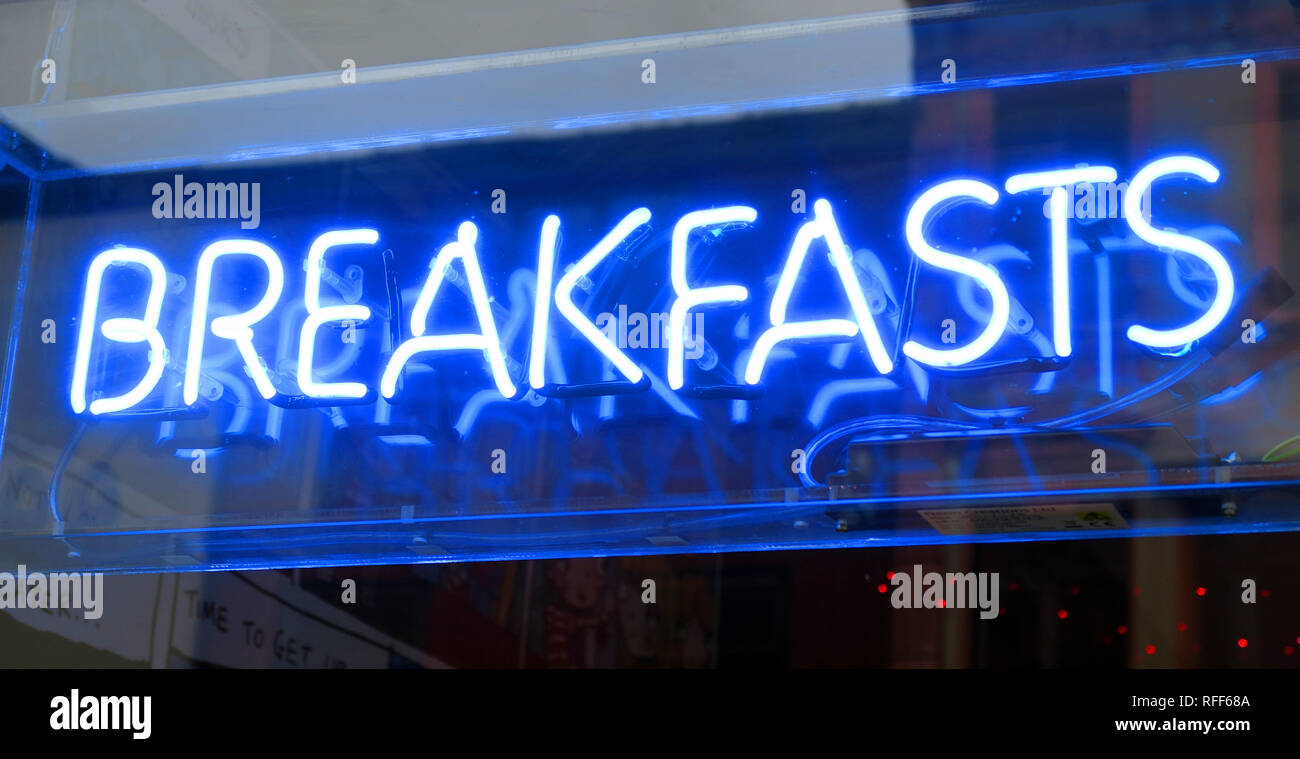Blue Breakfasts neon sign, Oldham street cafe, central Manchester, Northern Quarter, England, UK - Stock Image