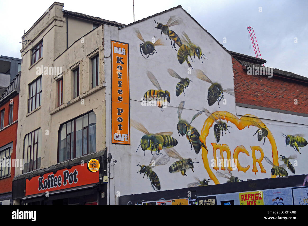 The Koffee Pot cafe,Oldham Street, 22 worker bees representing the 22 people killed, in the Manc Arena bombing,by graffiti artist Russell Meeham,Qubek - Stock Image