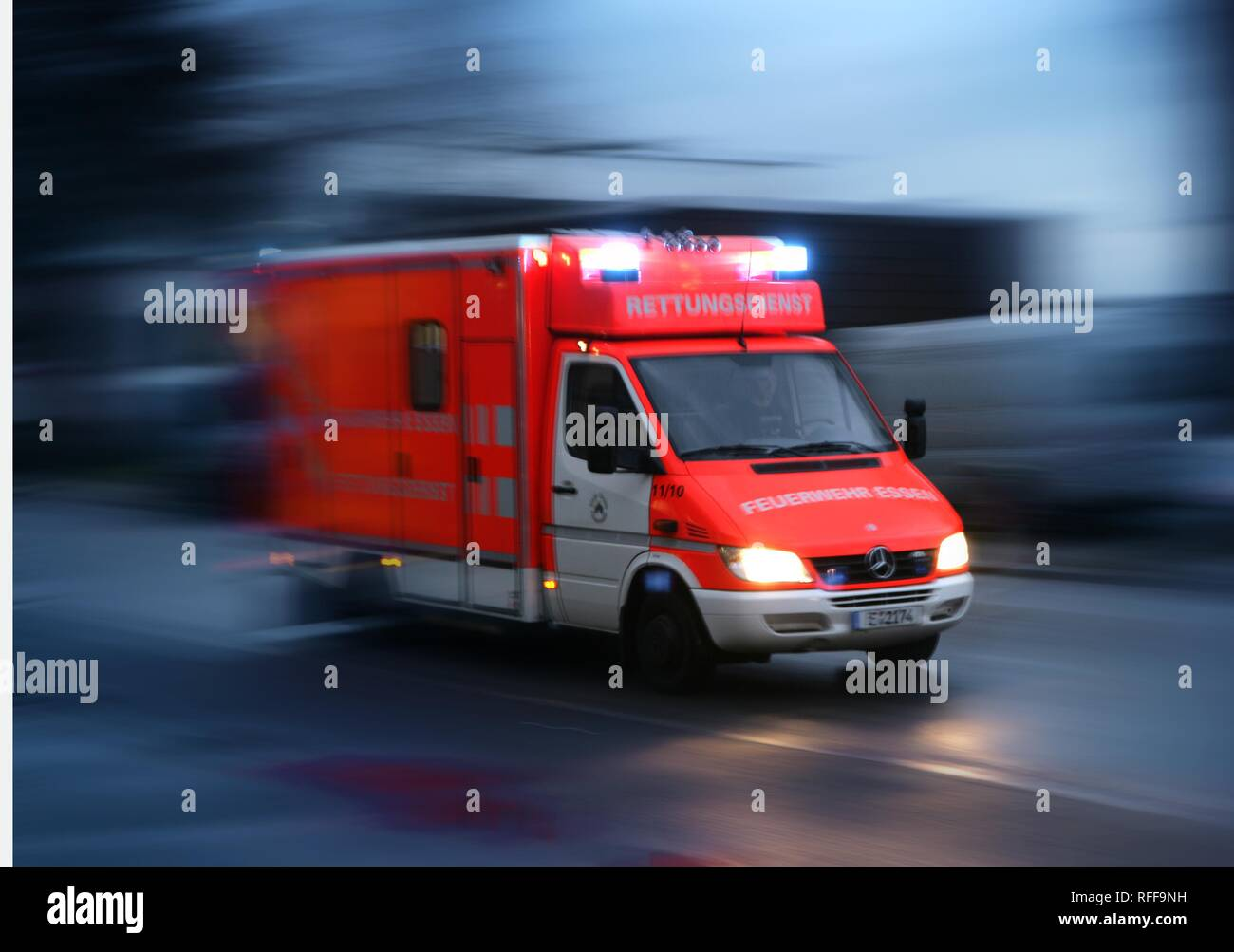 DEU Germany: Essen fire brigade. Ambulance on the way to an emergency with flashing blue lights.| Stock Photo