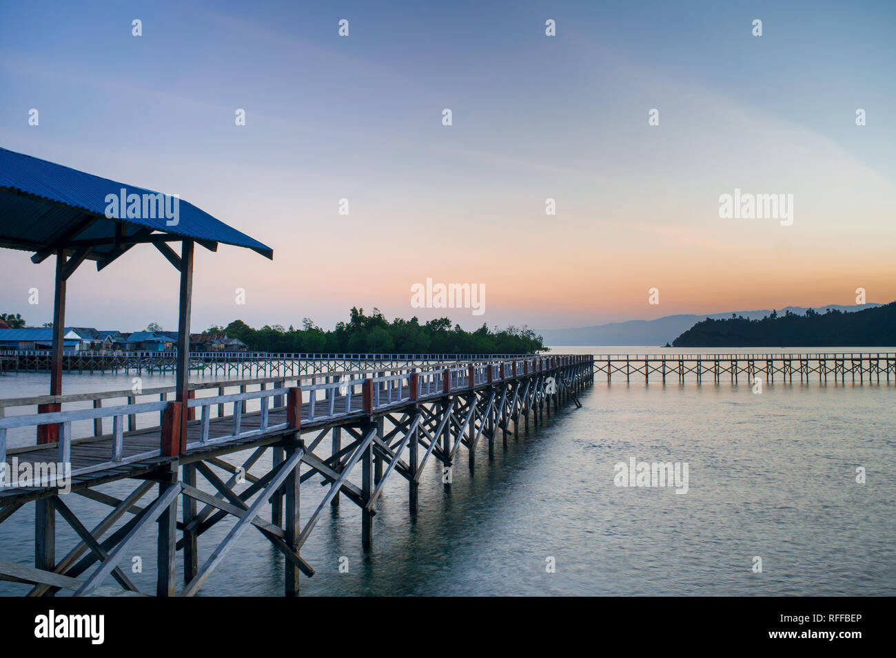 Pandan Island Morning View With It's New Wooden Harbor In Tolitoli, Central Sulawesi, Indonesiafgvhbjnkml - Stock Image