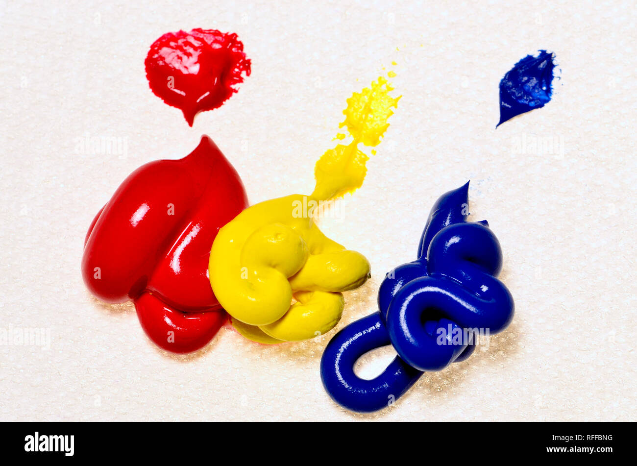 Primary Colours - watercolour paints on canvas. Red, yellow, blue - Stock Image