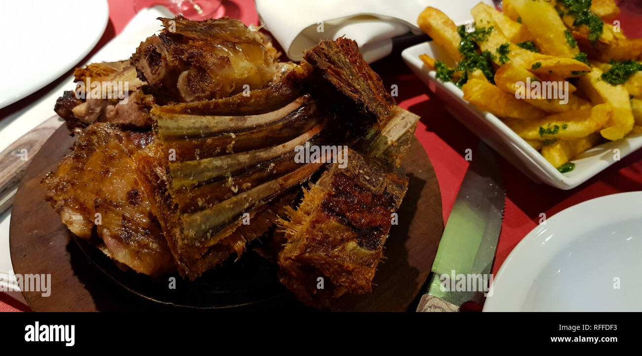 Cordero Patagonico (Patagonian lamb) barbecue, El Calafate, Argentina. The Patagonian lamb is an animal between 2 and 3 months old - Stock Image