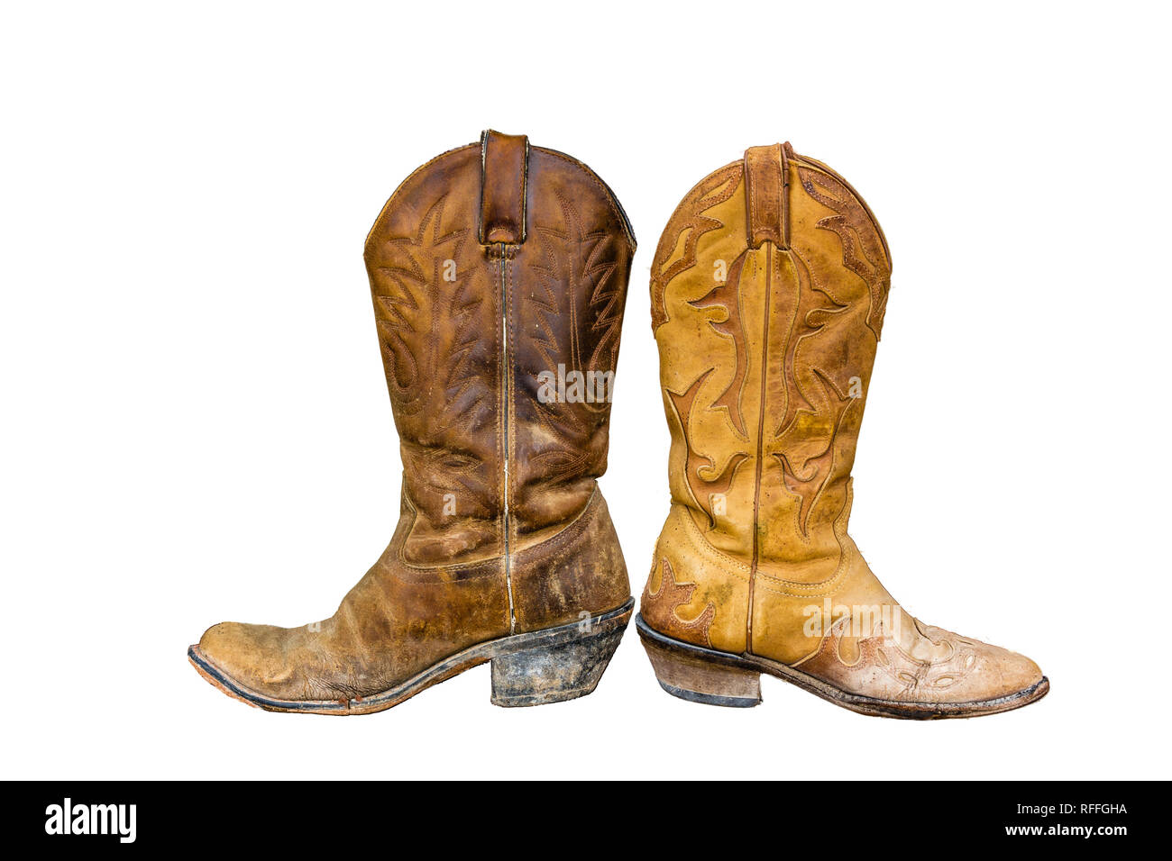 10d61794bbd pair of worn cowboy boots brown and yellow isolate against white ...