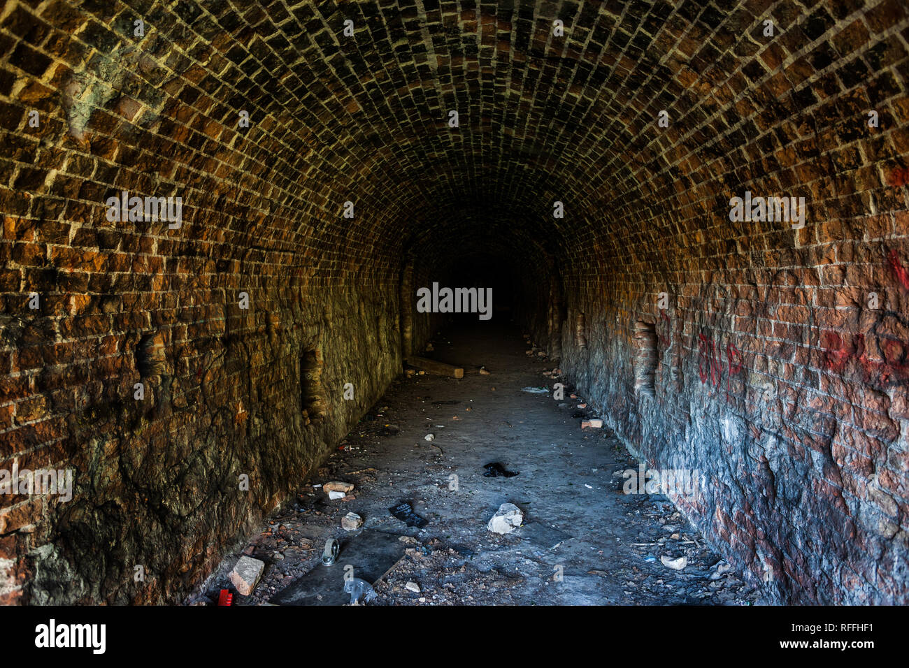 Grunge, spooky arched corridor in an abandoned Fort Bema building, urban exploration in Warsaw, Poland - Stock Image