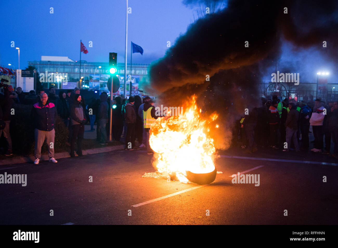 Taxi drivers are seen burning containers and wheels during the