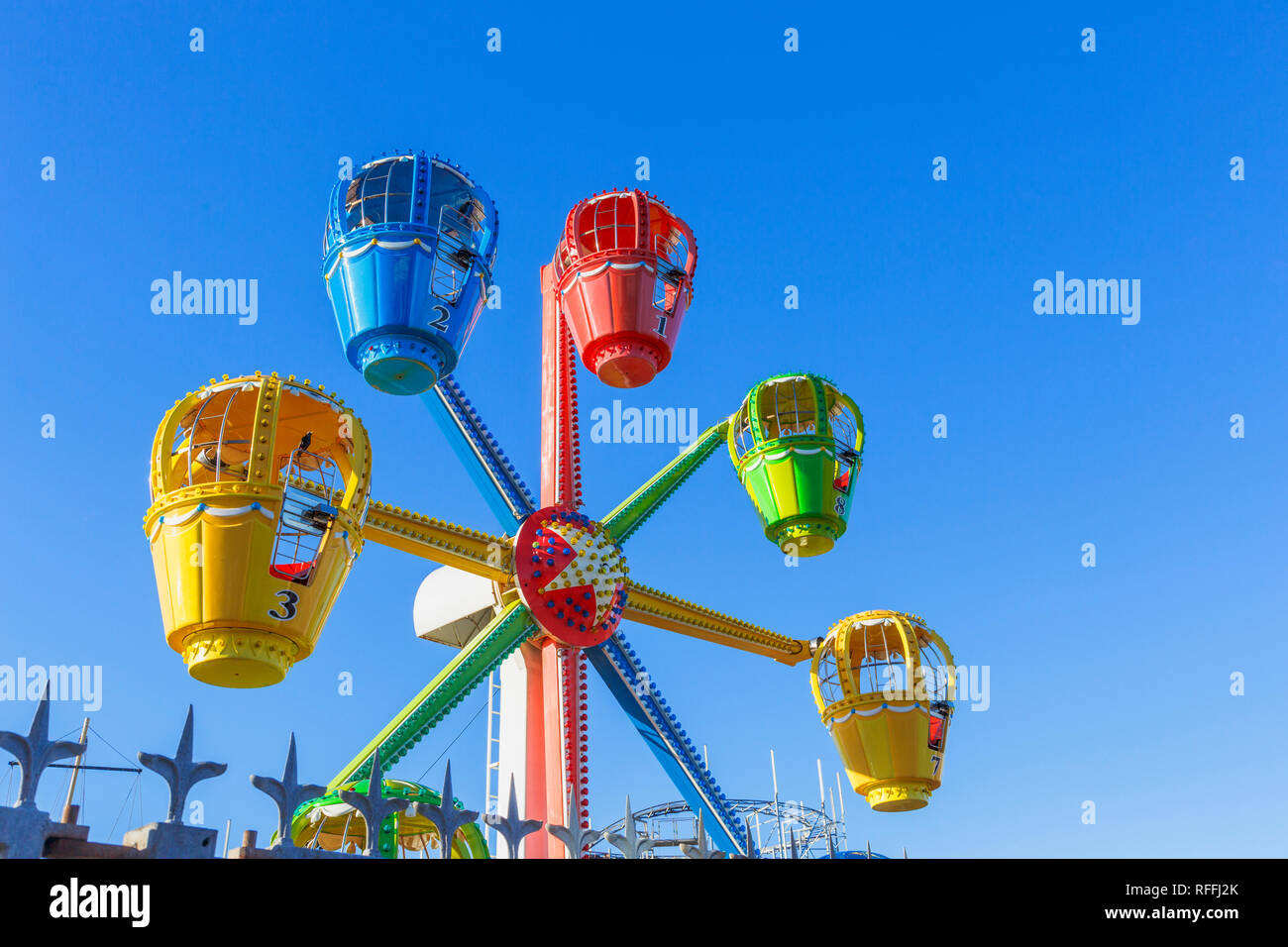 Brightly coloured ferris wheel ride at a funfair on Clarence Pier, Clarence Esplanade, Southsea, Portsmouth, UK Stock Photo