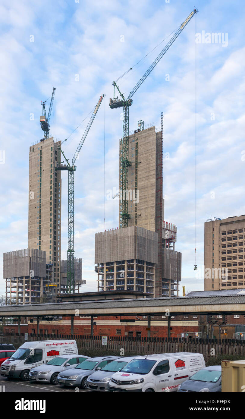 Large concrete cores of the new high rise Victoria Square mixed-use retail development in the town centre under construction in Woking, Surrey, UK - Stock Image