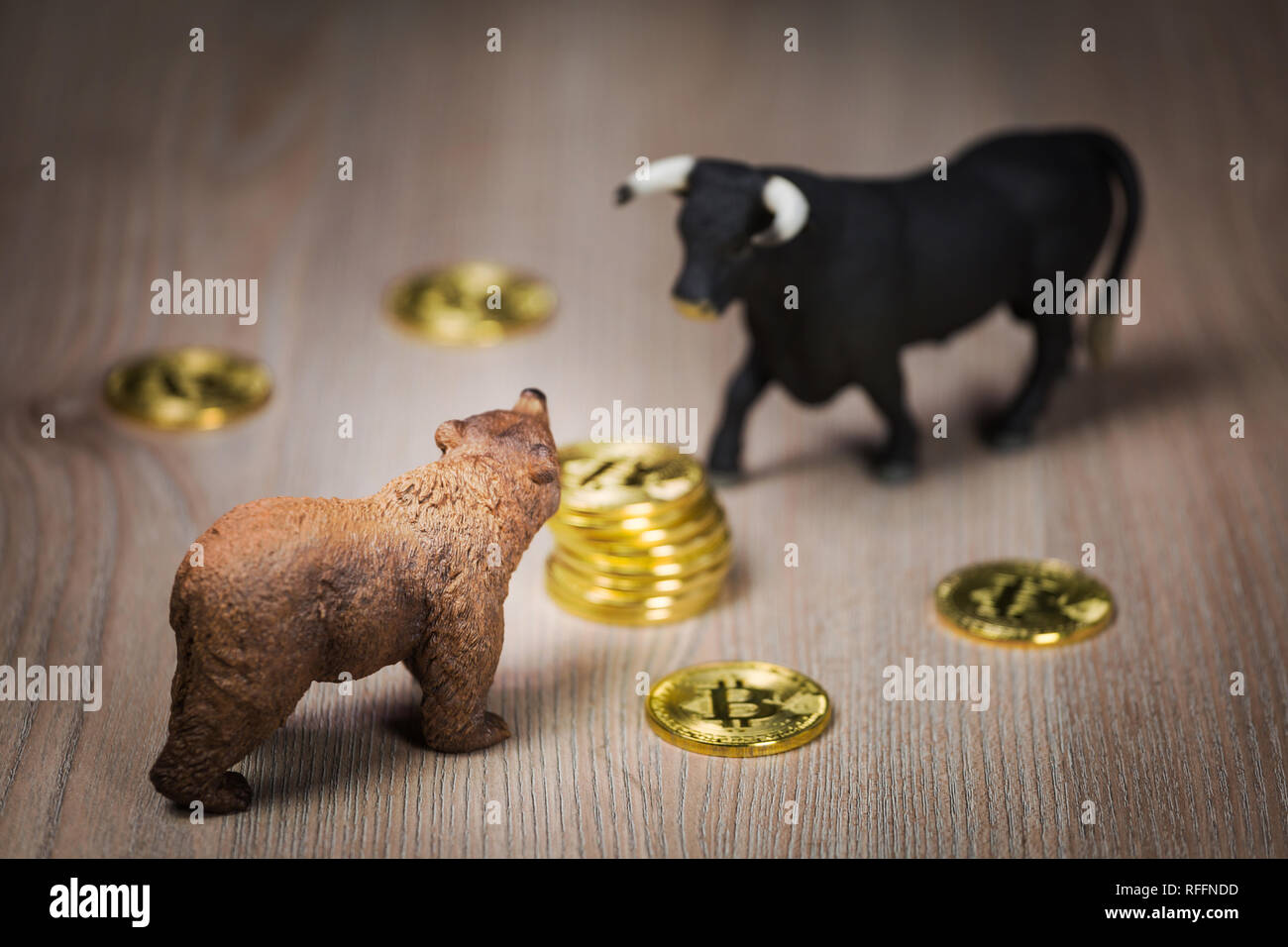 Cryptocurrency bitcoin bear and bull figures on a wooden table. Bearish or bullish market trend concept Stock Photo
