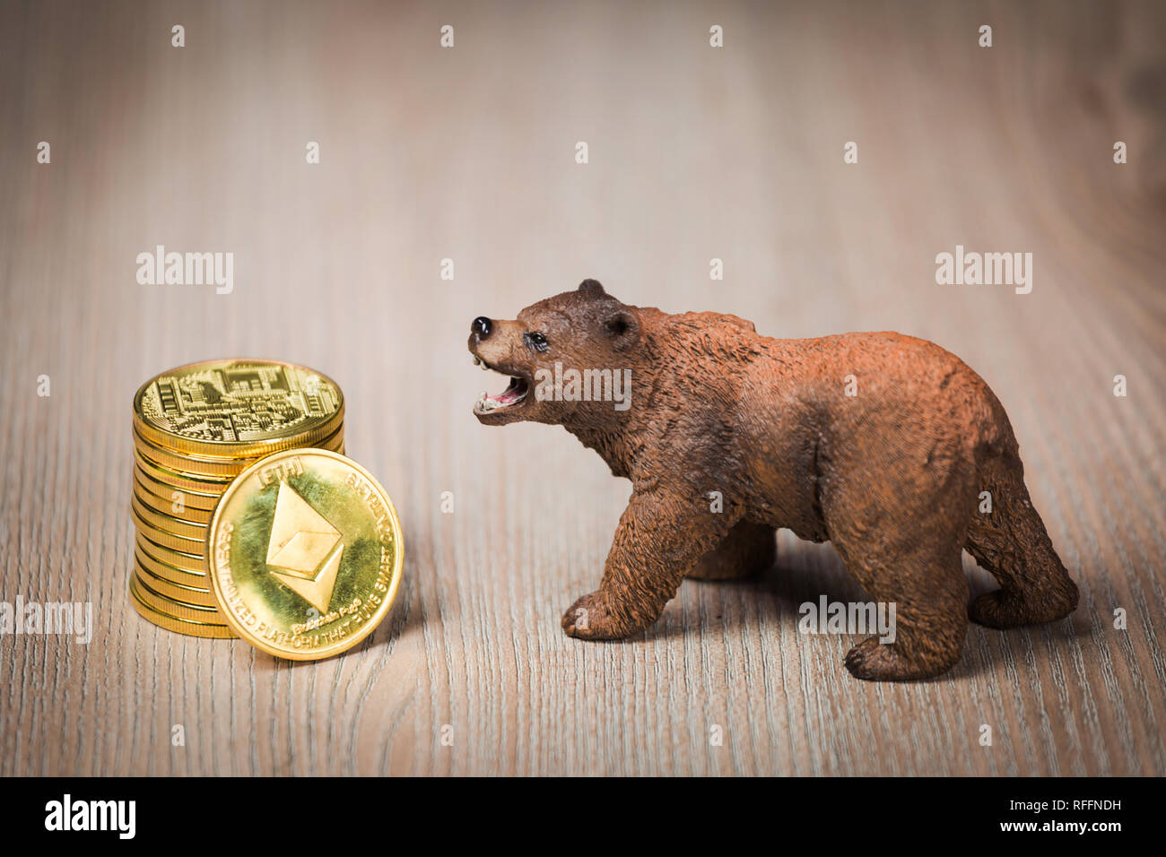 Cryptocurrency ethereum bear figure on a wooden table. Bearish market trend concept Stock Photo