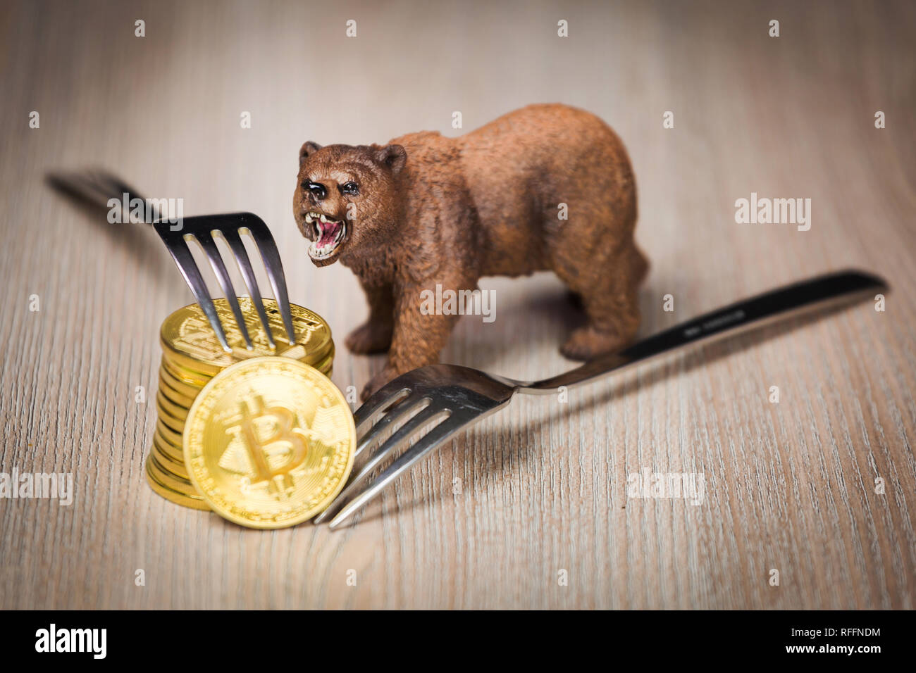 Cryptocurrency bitcoin bear figure on a wooden table. Bearish market trend concept - Stock Image