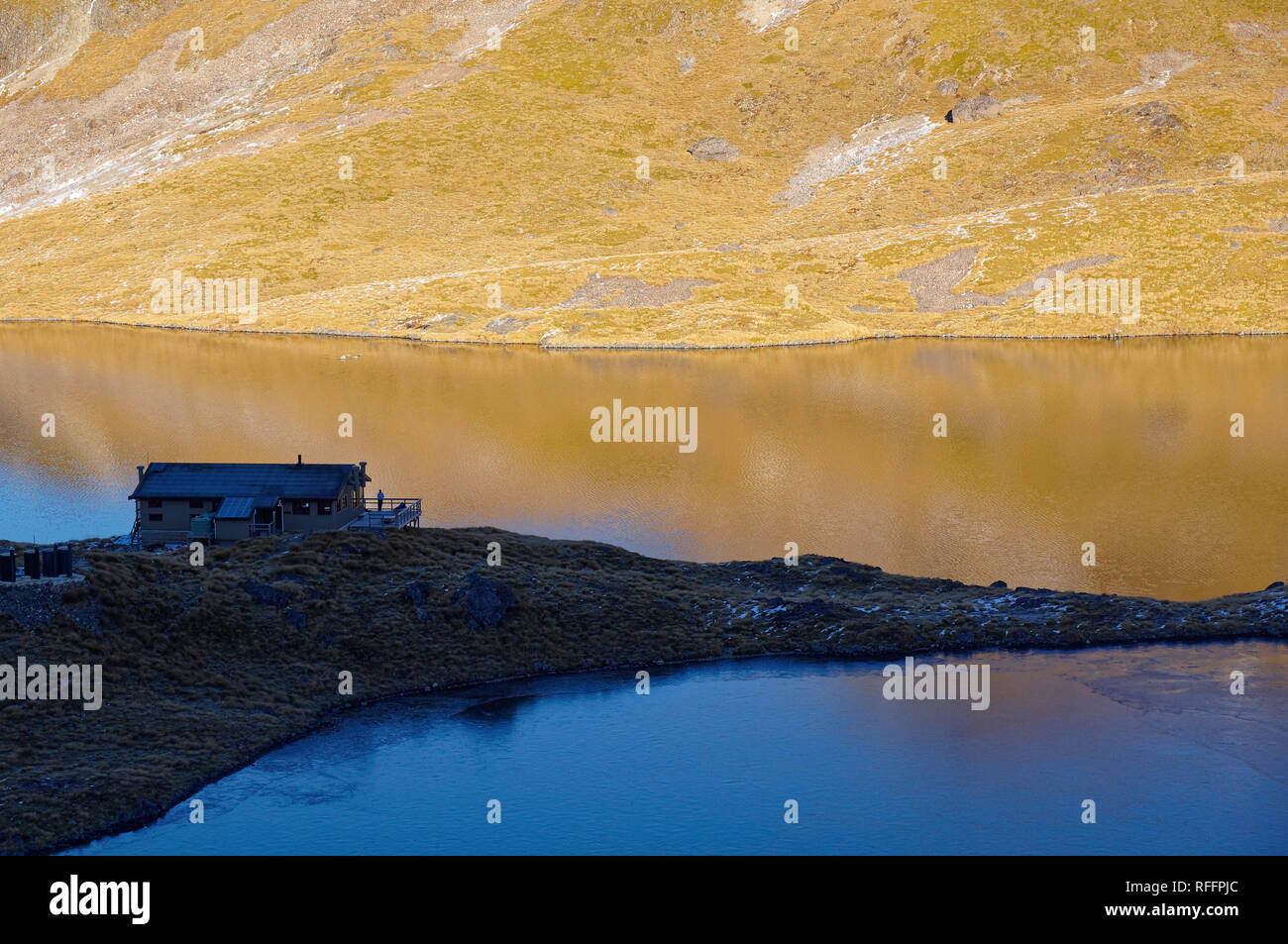 Angelus hut at sunrise, DoC hut or Dept of Conservation hut, Nelson Lakes National Park, New Zealand. - Stock Image