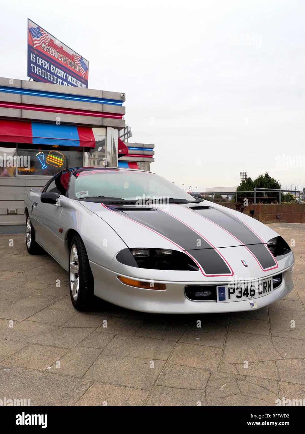 A silver fourth generation Chevrolet Camaro sports coupe from the late 1990's at a classic car meet in Great Yarmouth. Stock Photo