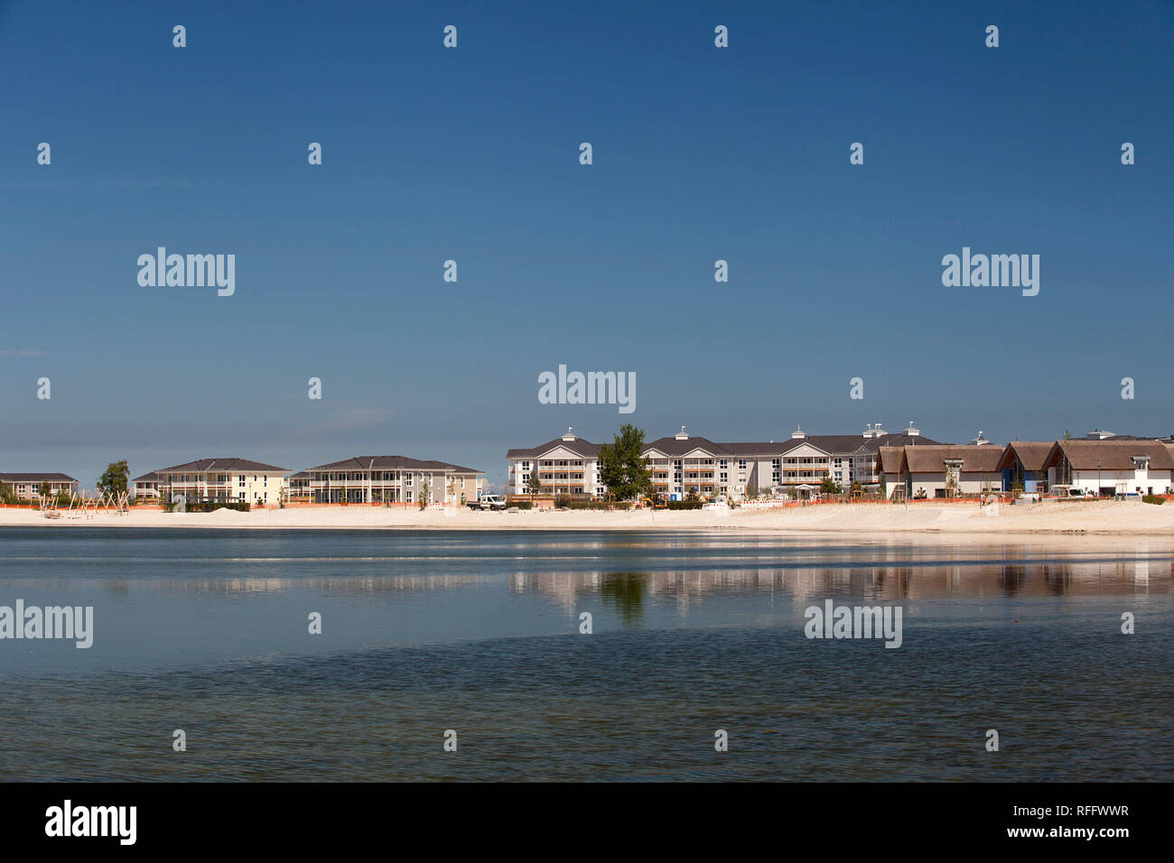View over inland lake to holiday park Heiligenhafen, Schleswig-Holstein, Germany, Europe - Stock Image