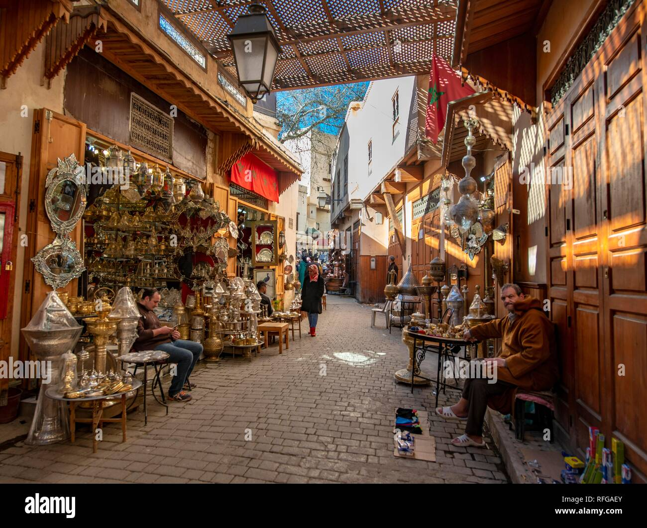 676c983f1cd4d Shop with metal and copper goods, narrow alleyway, Arab market, Shouk, Fez