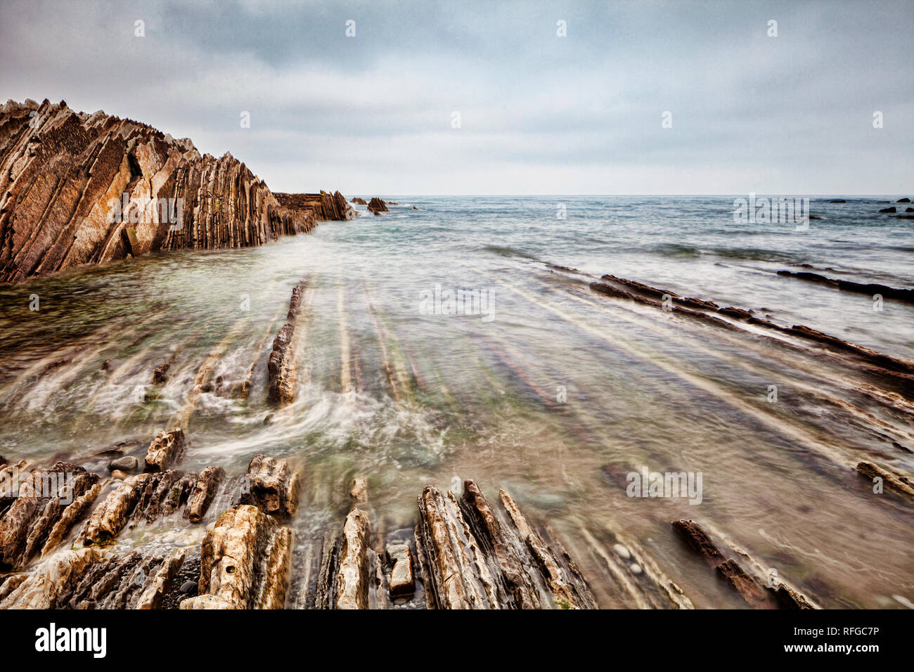 Flysch formation at Itzurun Beach, Basque Country, Spain - Stock Image