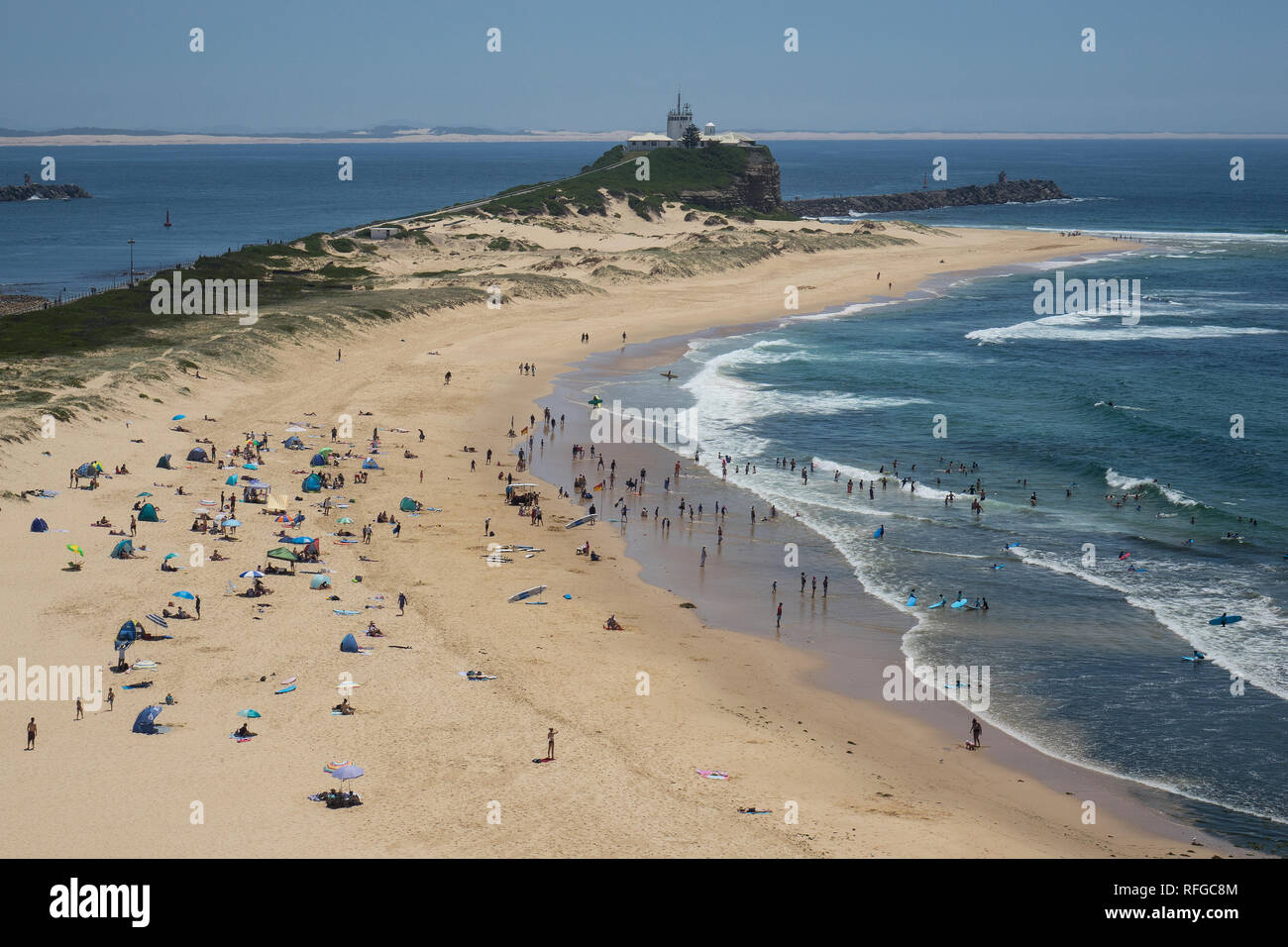 Australia, New South Wales, Newcastle, Nobby's beach & lighthouse - Stock Image