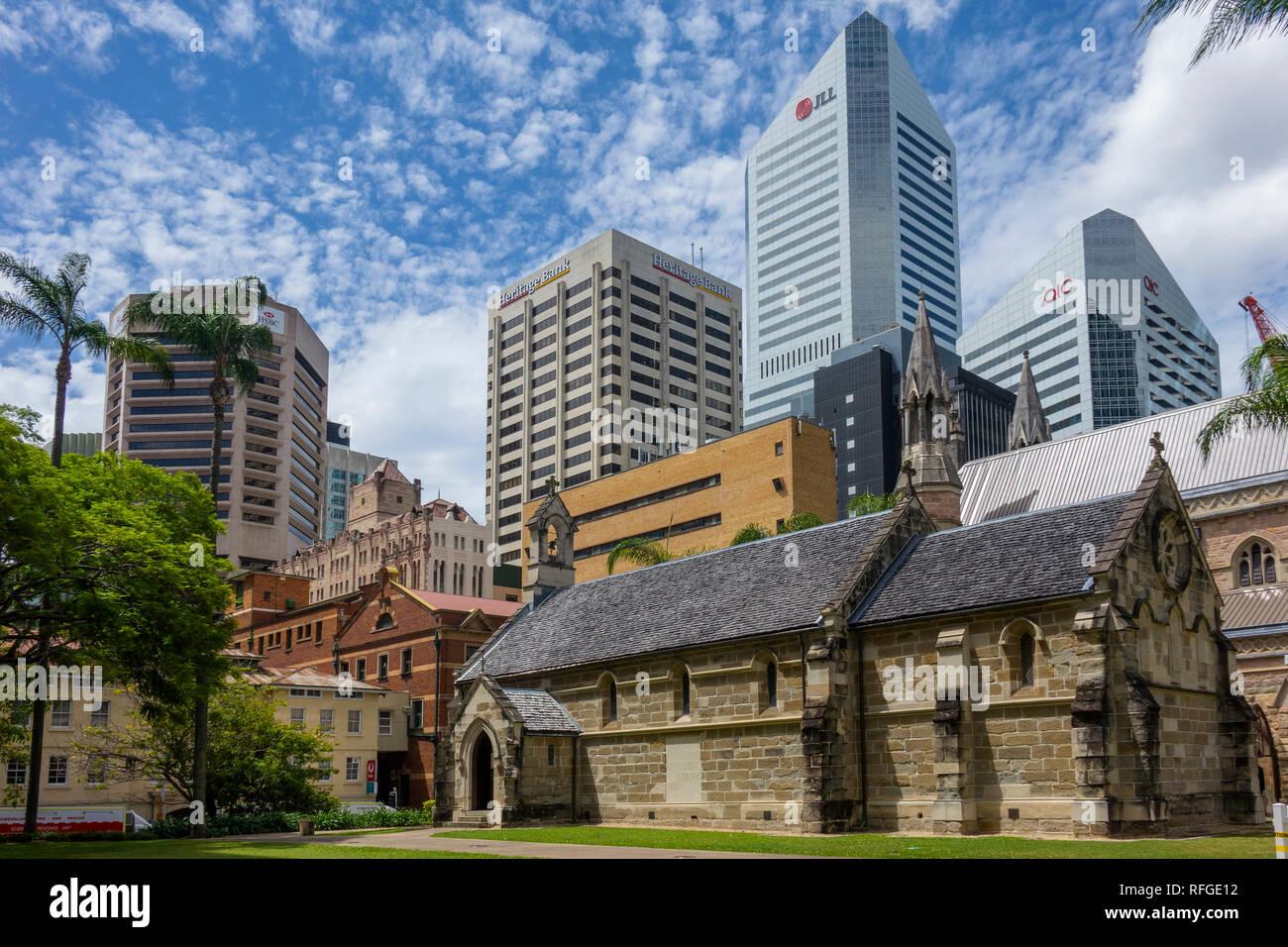 Australia, Queensland, Brisbane, St.Stephens cathedral chapel & modern city - Stock Image