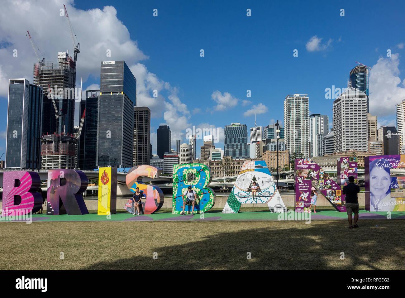 Australia, Queensland, Brisbane, skyline and colourful 'Brisbane' sign - Stock Image