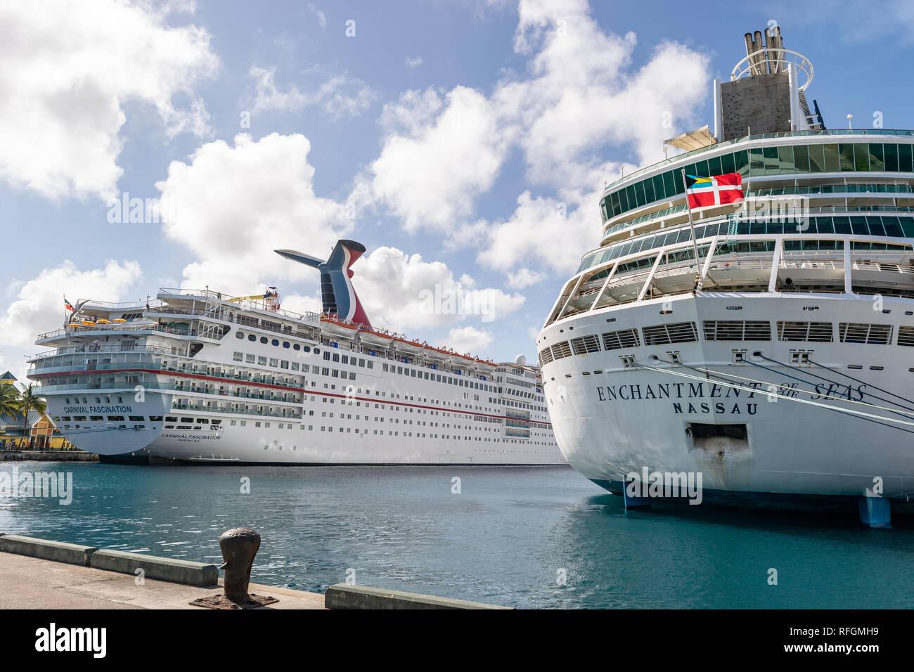 Nassau, Bahamas - December 02 2015: Carnival Fascination and Royal Caribbean Enchantment of the Seas cruise ships moored at the Cruise Port - Stock Image
