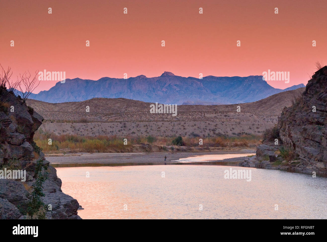 Chisos Mountains seen over Rio Grande from Santa Elena Canyon at sunset, Chihuahuan Desert in Big Bend National Park, Texas, USA Stock Photo