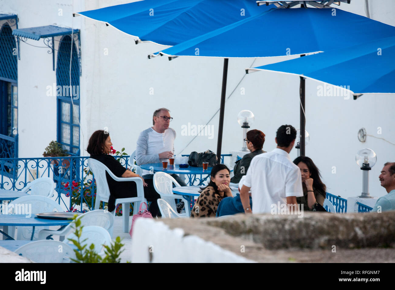People sitting in cafe in the centrum of Sidi Bou Said - Stock Image