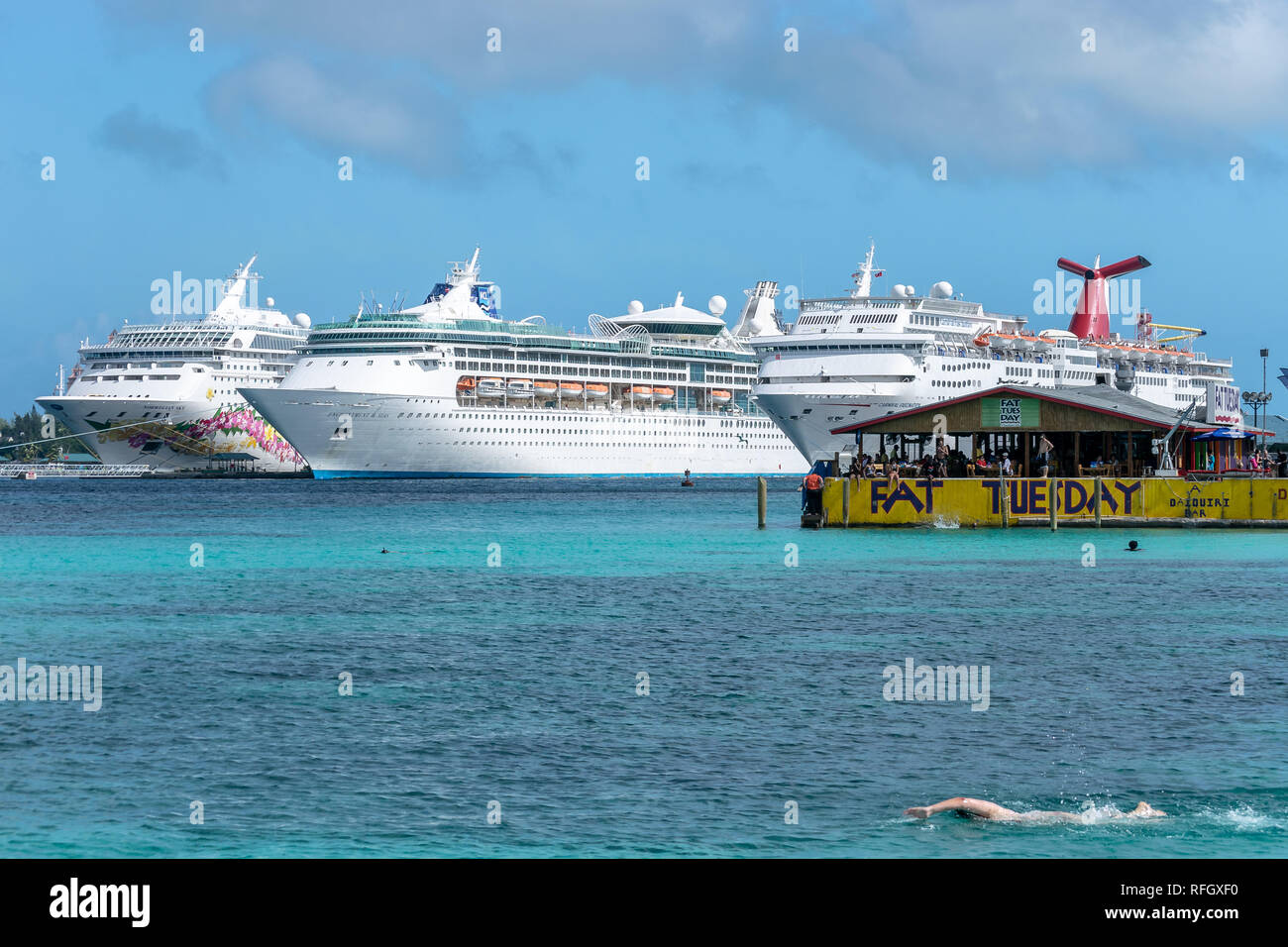Nassau, Bahamas - December 02 2015: Norwegian Sky, Royal Caribbean Enchantment of the Seas and Carnival Fascination cruise ships docked in Nassau - Stock Image