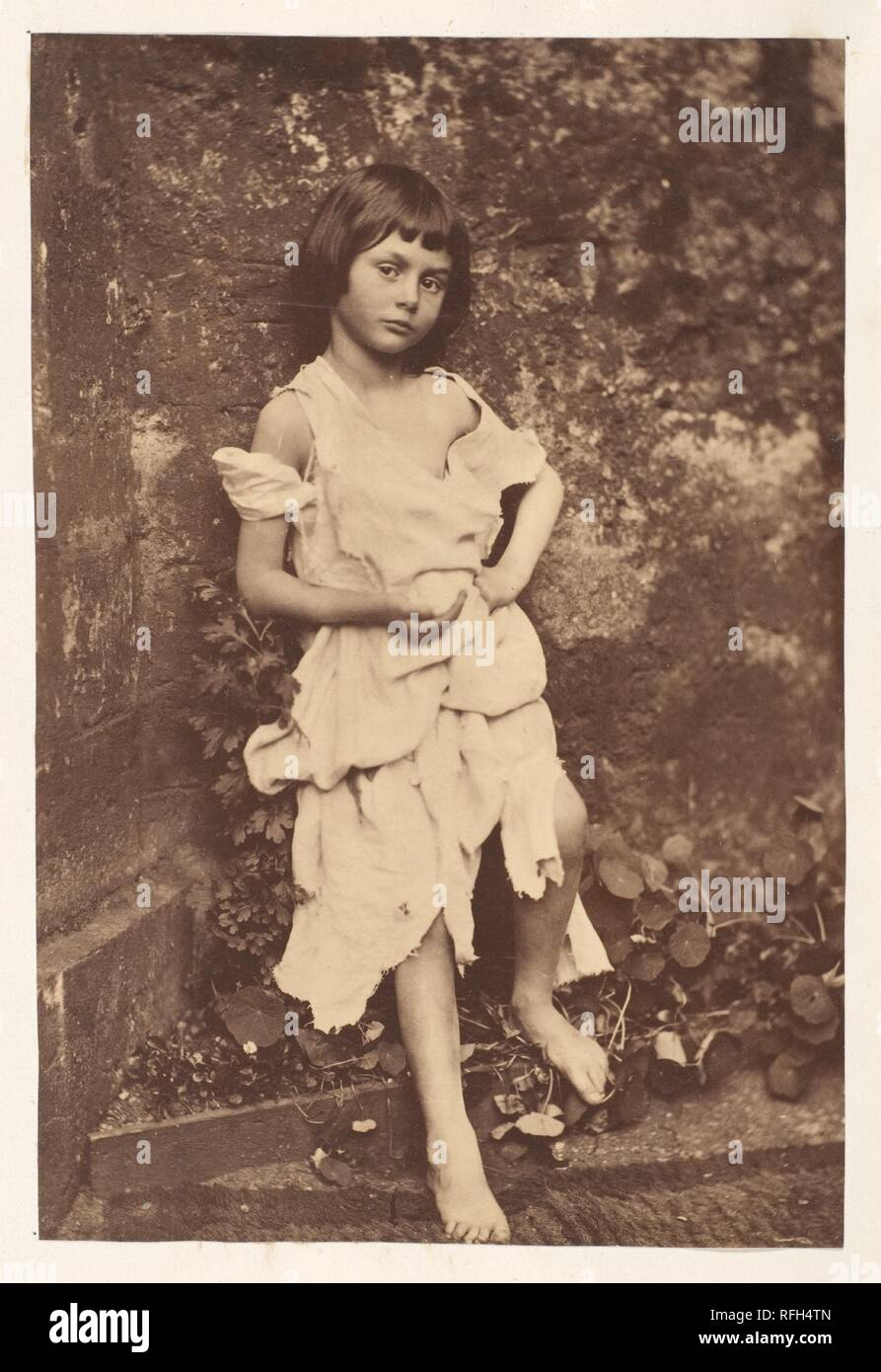 Alice Liddell as 'The Beggar Maid'. Artist: Lewis Carroll (British, Daresbury, Cheshire 1832-1898 Guildford). Dimensions: Image: 16.3 x 10.9cm (6 7/16 x 4 5/16in.)  Mount: 14 1/8 in. × 10 7/8 in. (35.8 × 27.6 cm). Subject: Alice Pleasance Liddell (British, 1852-1934). Date: 1858.  Known primarily as the author of children's books, Lewis Carroll was also a lecturer in mathematics at Oxford University and an ordained deacon. He took his first photograph in 1856 and pursued photography obsessively for the next twenty-five years, exhibiting and selling his prints. He stopped taking pictures abrupt - Stock Image