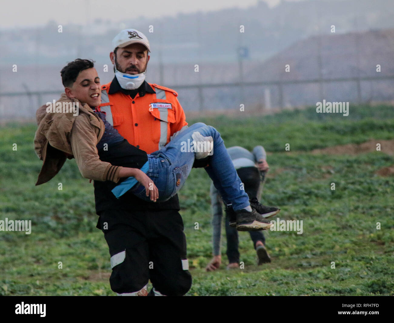 Medical Ahmed Abdel Bari Abu Foul Seen Carrying A Young Man Injured During The ClashesPalestinian Citizens And Zionist Occupation Forces Clashed North