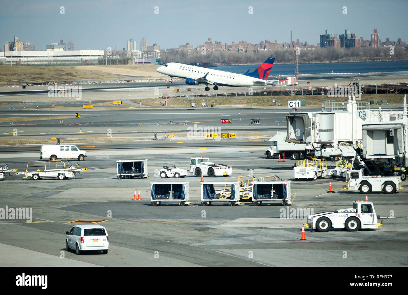 New York, USA. 25th Jan, 2019. Vehicles are seen at the LaGuardia Airport in New York, the United States, on Jan. 25, 2019. The U.S. Federal Aviation Administration on Friday halted flights bound for New York City's LaGuardia Airport, due to staff shortage caused by the historic government shutdown. Credit: Wang Ying/Xinhua/Alamy Live News - Stock Image