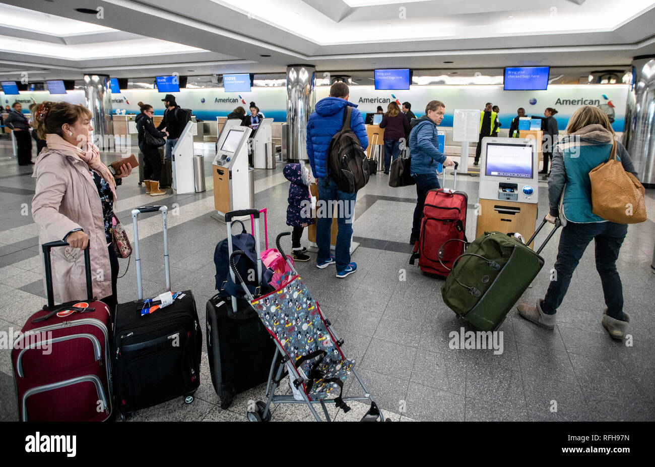 New York, USA. 25th Jan, 2019. Passengers prepare to check in at the LaGuardia Airport in New York, the United States, on Jan. 25, 2019. The U.S. Federal Aviation Administration on Friday halted flights bound for New York City's LaGuardia Airport, due to staff shortage caused by the historic government shutdown. Credit: Wang Ying/Xinhua/Alamy Live News - Stock Image
