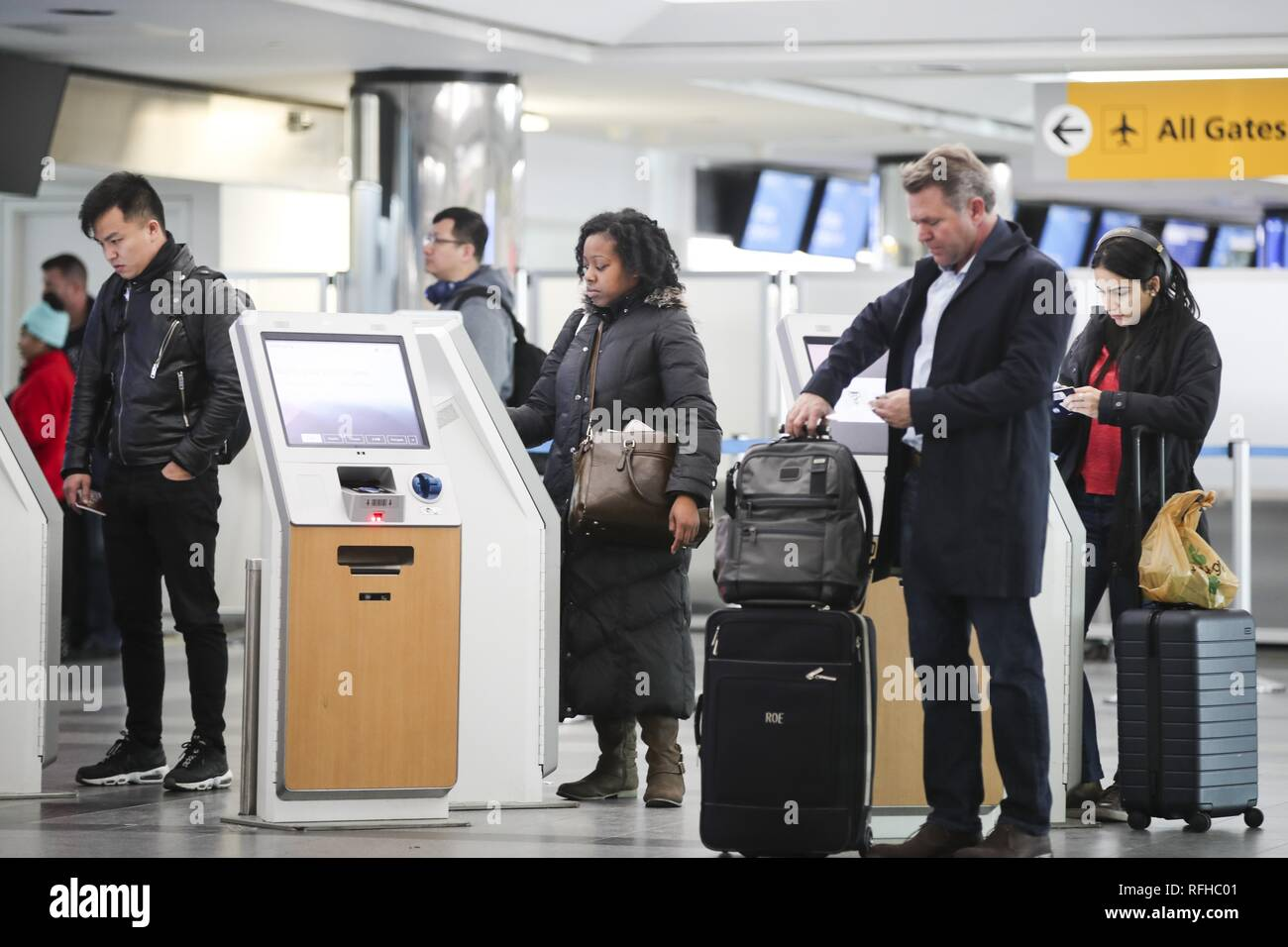 Beijing, USA. 25th Jan, 2019. Passengers use self-service kiosks to check in at the LaGuardia Airport in New York, the United States, on Jan. 25, 2019. The U.S. Federal Aviation Administration on Friday halted flights bound for New York City's LaGuardia Airport, due to staff shortage caused by the historic government shutdown. Credit: Wang Ying/Xinhua/Alamy Live News - Stock Image