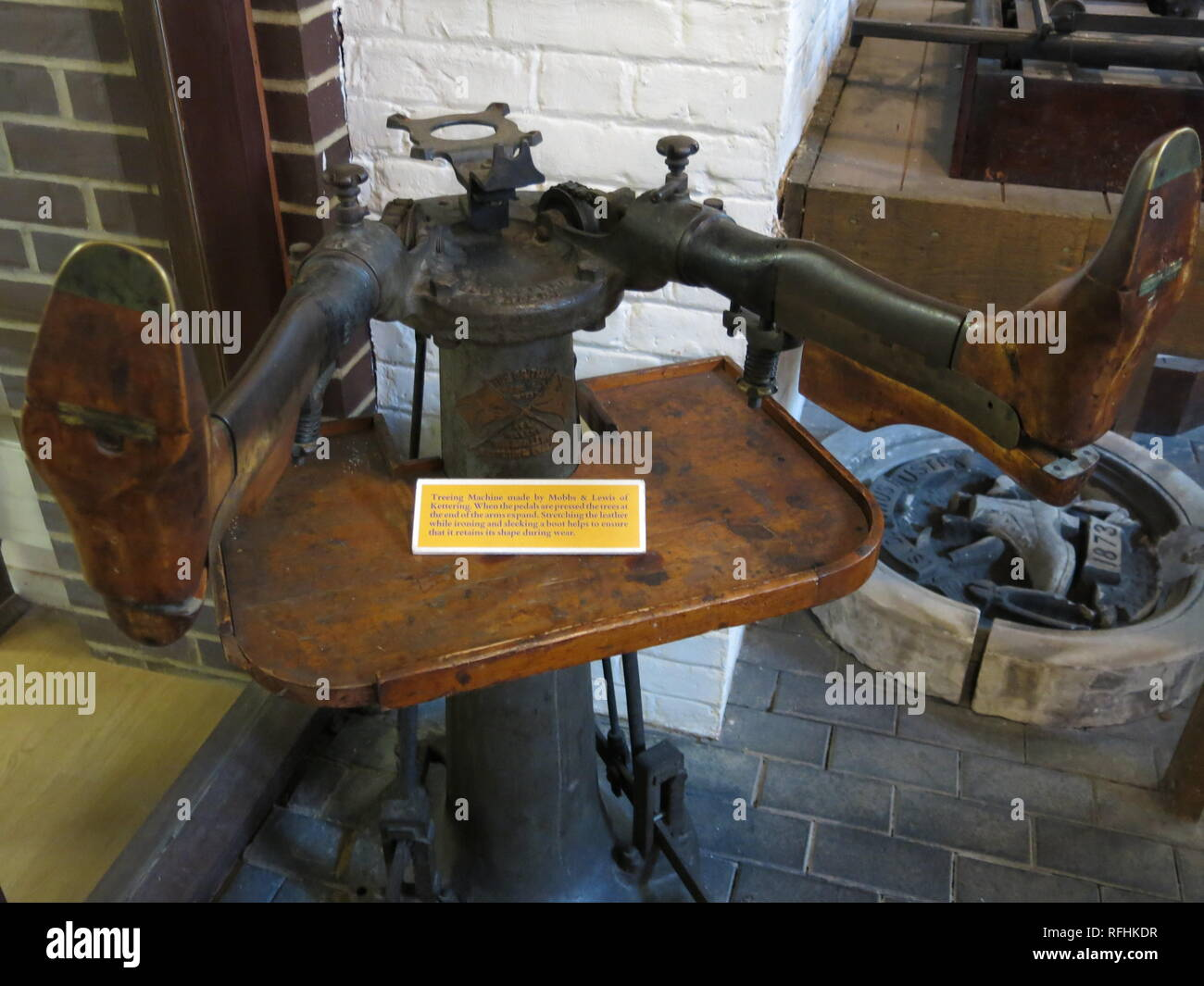 Photo of a treeing machine made by Mobbs & Lewis for stretching leather in the boot and shoe industry; display at the Manor House Museum, Kettering. - Stock Image