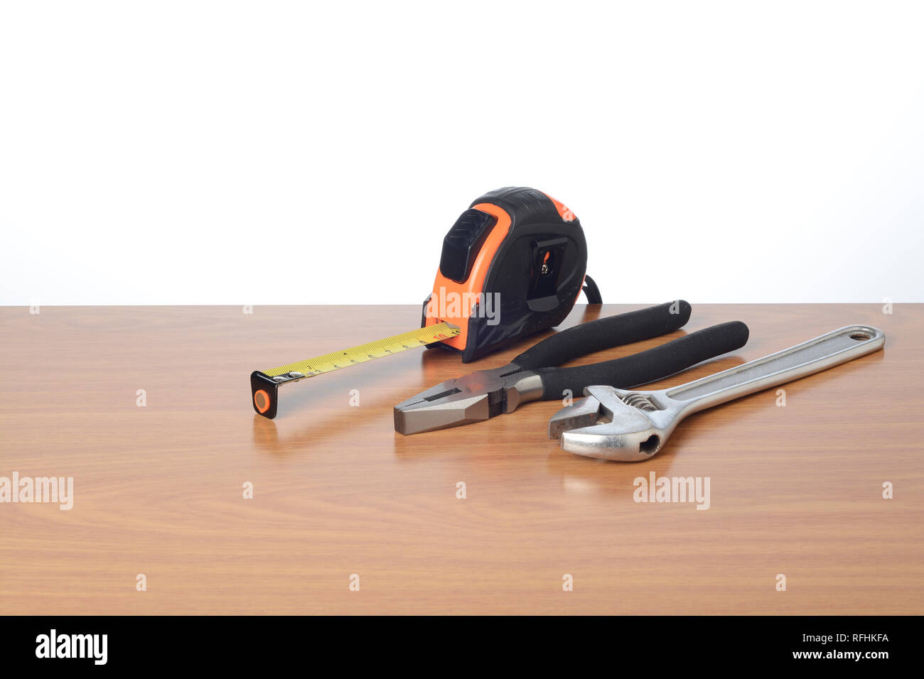 Tools on the table, tape measure, wrench and pliers - Stock Image
