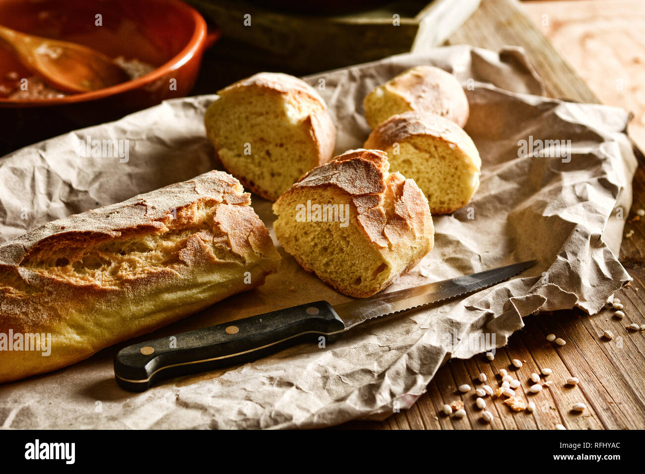 hot sliced bread on wooden table - rustic effect - closeup - Stock Image