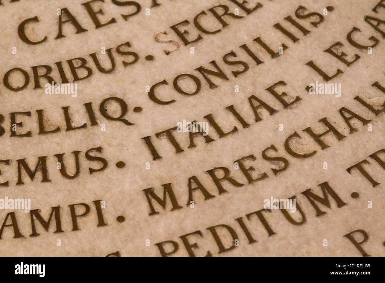 Pavia, Italy. November 16 2017. Latin inscriptions on the floor in the 'Chiesa dei Santi Gervasio e Protasio Martiri' - Stock Image