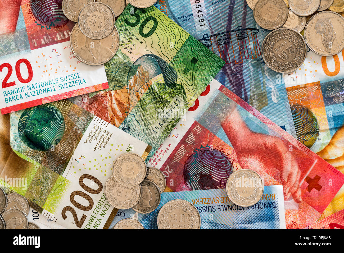 Swiss franc coins and bank notes in different denominations close up view - Stock Image