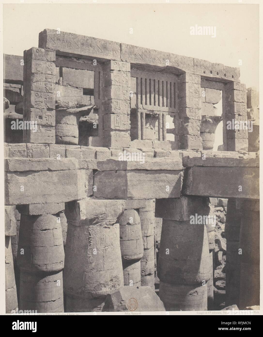 Karnak (Thèbes), Palais - Salle Hypostyle - Fenêtre et Chapiteaux des Galeries Latérales. Artist: Félix Teynard (French, 1817-1892). Dimensions: 30.7 x 25.5 cm. (12  1/16  x 10  1/16  in.). Printer: Imprimerie Photographique de H. de Fonteny et Cie. Date: 1851-52, printed 1853-54. Museum: Metropolitan Museum of Art, New York, USA. - Stock Image