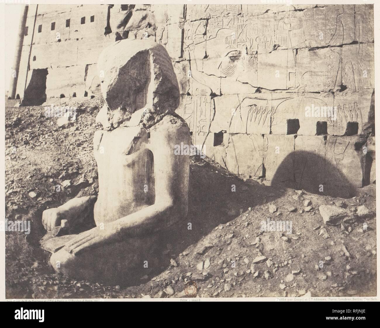 Karnak (Thèbes), Troisième Pylône - Colosse de Spath Calcaire, en D. Artist: Félix Teynard (French, 1817-1892). Dimensions: 24.0 x 30.3 cm. (9  7/16  x 11  15/16  in.). Printer: Imprimerie Photographique de H. de Fonteny et Cie. Date: 1851-52, printed 1853-54. Museum: Metropolitan Museum of Art, New York, USA. - Stock Image