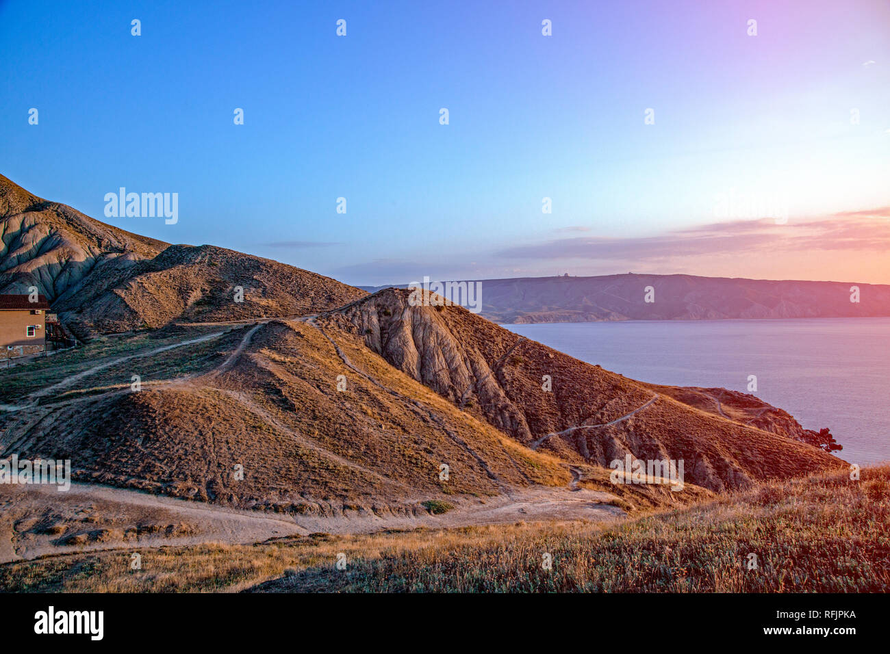 Awesome view to the sea from the top of hill with sunset Stock Photo