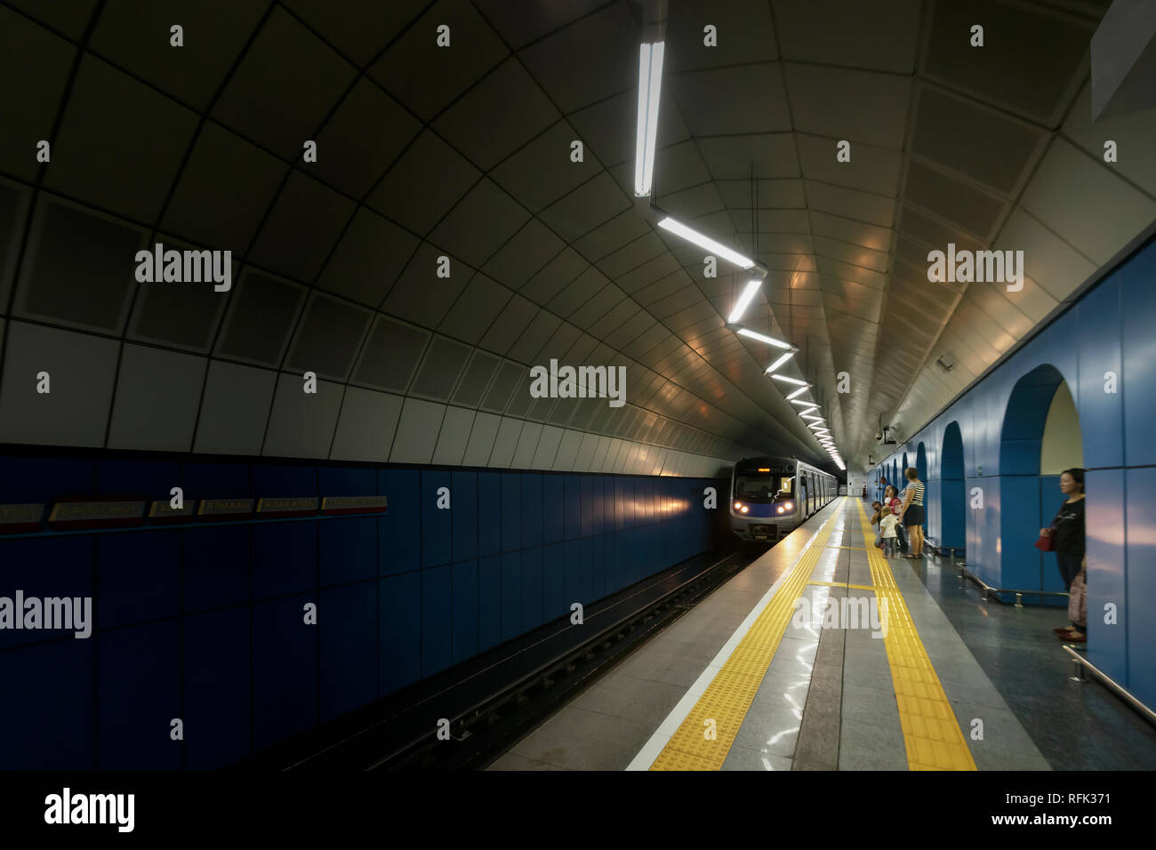 Train entering the subway station,, Baikonur Metro Station, Almaty, Kazakhstan - Stock Image