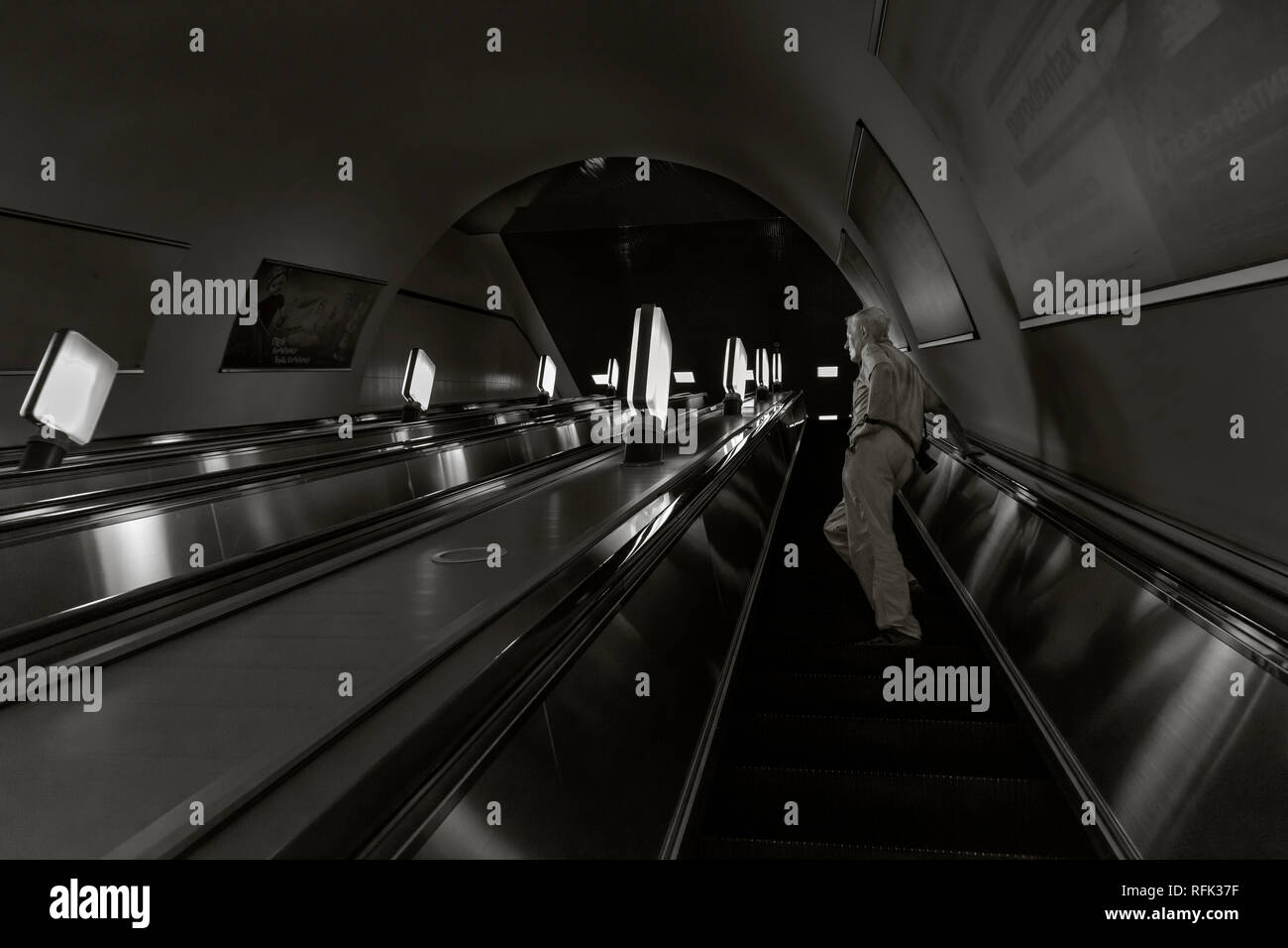 Man on an escalator, Baikonur Metro Station, Alamty, Kazakhstan - Stock Image
