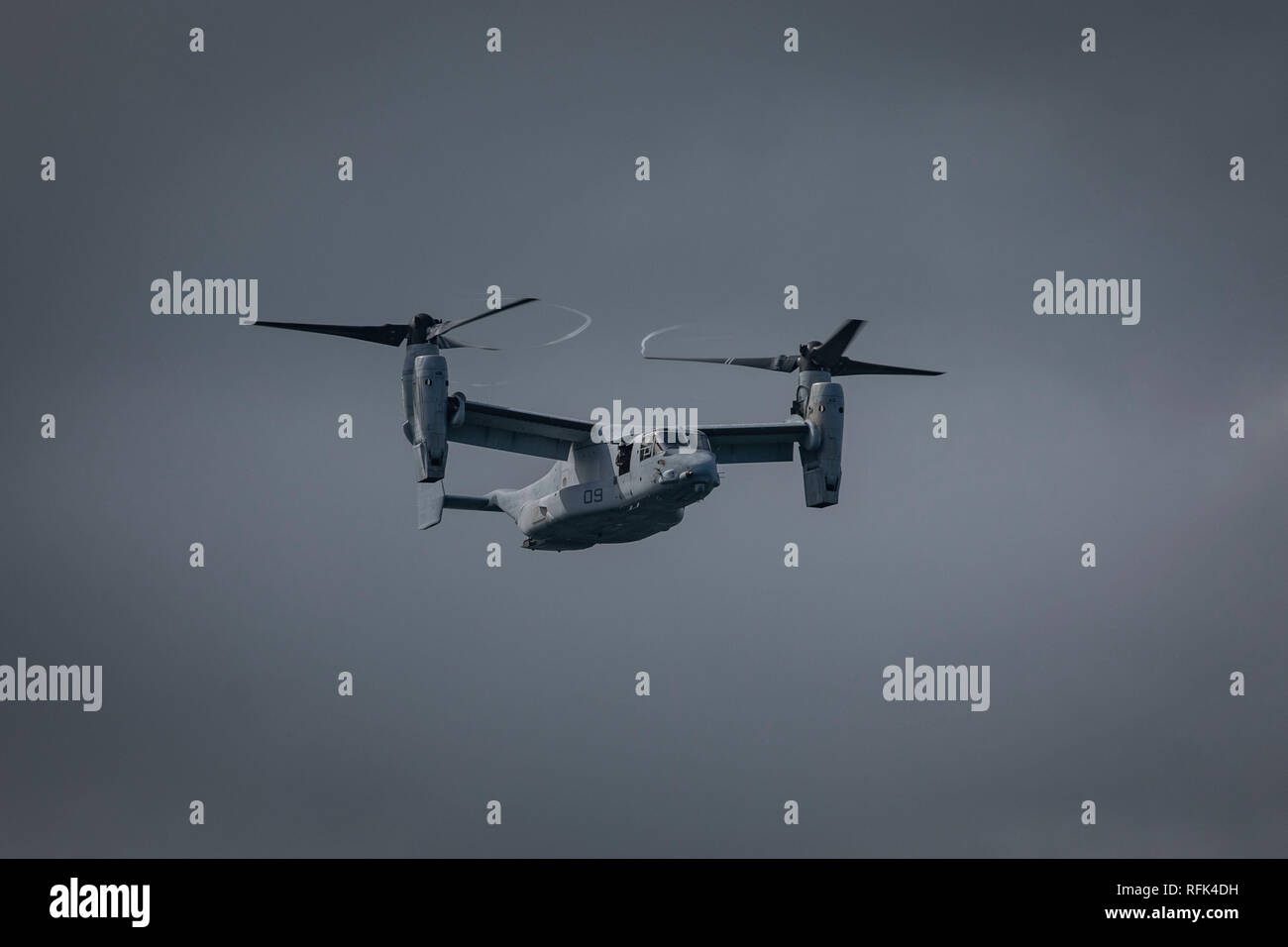 An MV-22B Osprey aircraft assigned to Marine Medium Tiltrotor Squadron (VMM) 363, gets into position prior to Rescue Hoist Training off the shore of Marine Corps Base Hawaii, Jan. 24, 2019. The purpose of this training is to enhance evacuation capabilities of personnel utilizing the MV-22B Osprey in the event of a military or civilian mishap at sea. The ability to hoist stranded individuals from the water with tiltrotor aircraft provides additional life-saving response options for Hawaii-based Marine's and the III Marine Expeditionary Force. (U.S. Marine Corps photo by Sgt. Jesus Sepulveda Tor Stock Photo