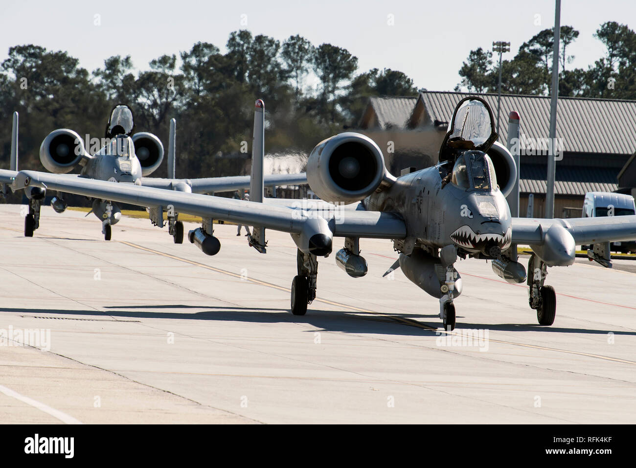 Airmen and aircraft from the 75th Fighter Squadron at Moody Air Force Base, Ga., return from supporting Operation Freedom's Sentinel, Jan. 25, 2019. The A-10C Thunderbolt II, which has an increased loiter time and weapons capabilities, deployed to southwest Asia in support of ground forces. (U.S. Air Force photo By Airman First Class Eugene Oliver) Stock Photo