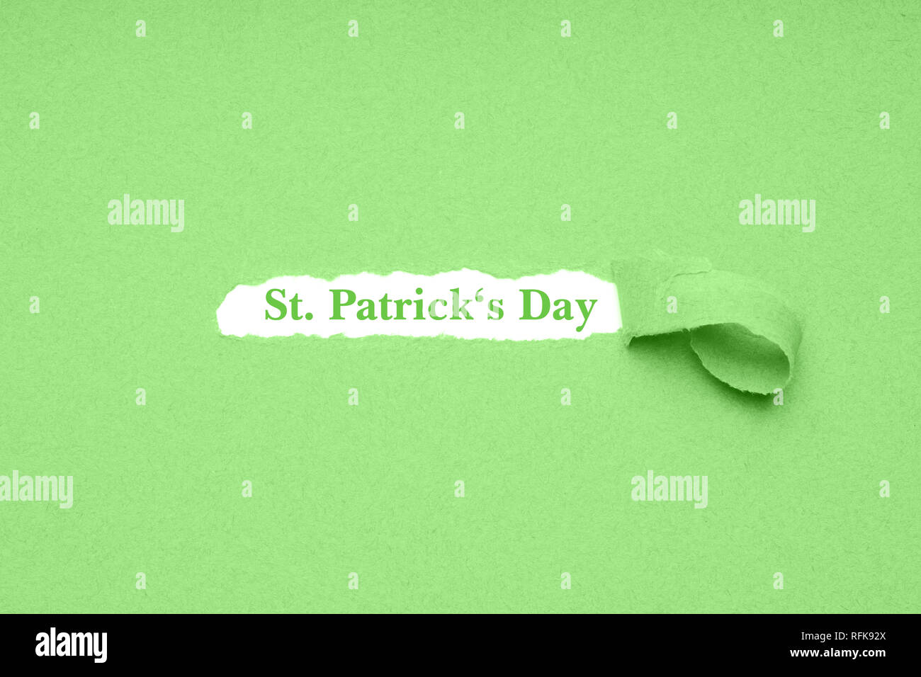 St. Patrick's Day is celebrated on March 17 - the irish national holiday is also known as Paddy's Day in Ireland - green paper background - Stock Image